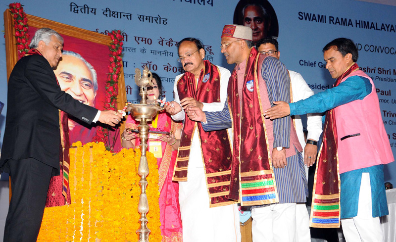 The Vice President, Shri M. Venkaiah Naidu lighting the lamp at the 2nd Convocation of Swami Rama Himalayan University, in Dehradun, Uttarakhand on December 05, 2017. The Governor of Uttarakhand, Shri Krishan Kant Paul, the Chief Minister of Uttarakhand, Shri Trivender Singh Rawat, the Minister of State for Higher Education, Uttarakhand, Dr. Dhan Singh Rawat and other dignitaries are also seen.